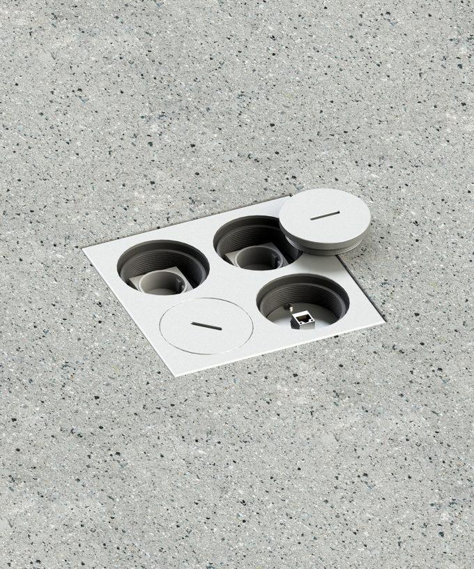 Bodensteckdose 7604A Aussenbereich im Betonboden eingebaut runde Deckel teilweise offen mit Schuko und RJ45